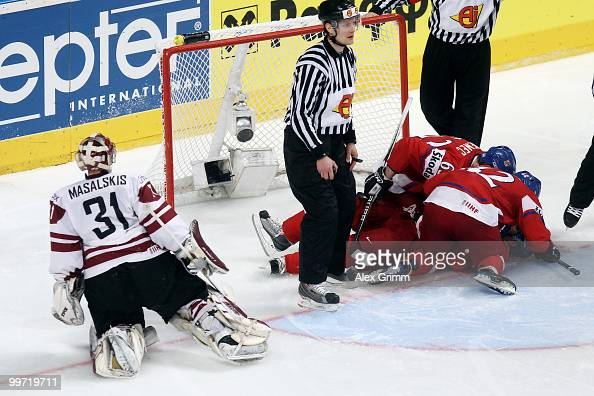 Tomas Rolinek of Czech Republic celebrates his team's first goal with teammates as goalkeeper Edgars Masalskis of Latvia reacts during the IIHF World...