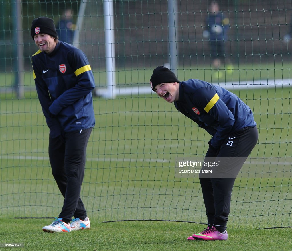 Tomas Rosicky and Andrey Arshavin of Arsenal share a joke during a training session at London Colney on March 12, 2013 in St Albans, England.