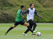 Tomas Rosicky and Francis Coquelin of Arsenal in action during a training session at London Colney on May 18 2013 in St Albans England