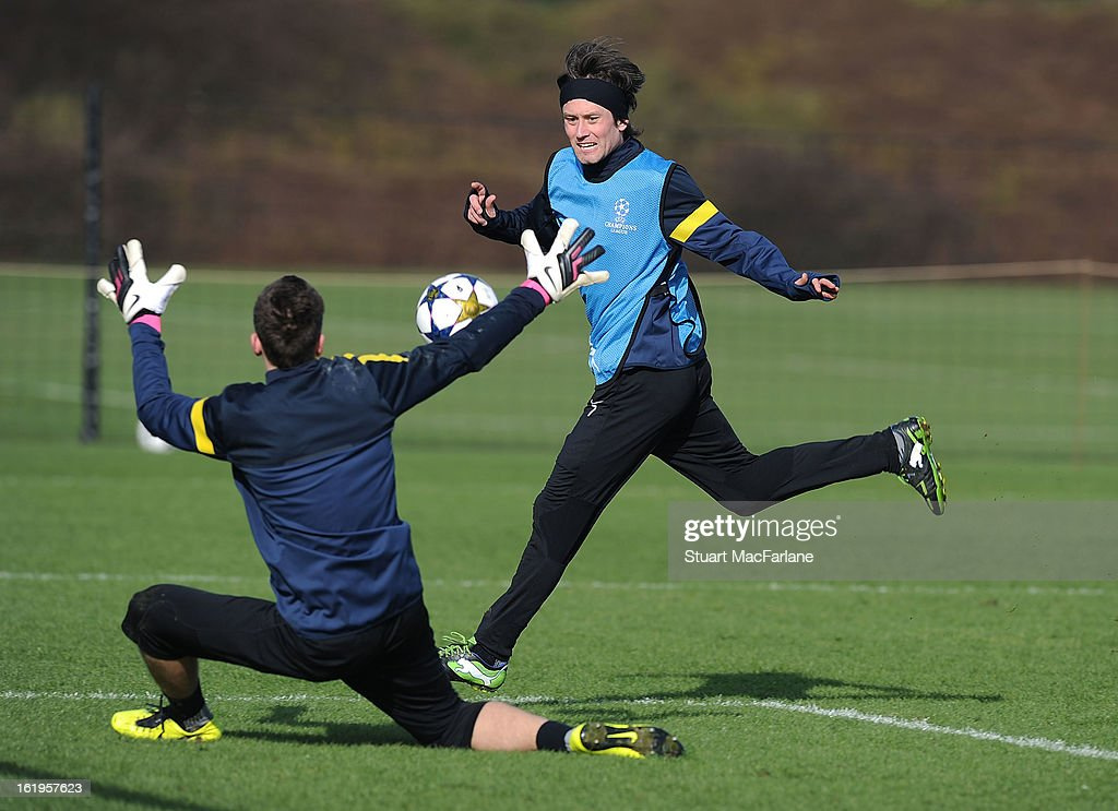 <a gi-track='captionPersonalityLinkClicked' href=/galleries/search?phrase=Tomas+Rosicky&family=editorial&specificpeople=213988 ng-click='$event.stopPropagation()'>Tomas Rosicky</a> (R) and goalkeeper Wojceich Szczesny of Arsenal in action during a training session ahead of their UEFA Champions League match against FC Bayern Muenchen at London Colney on February 18, 2013 in St Albans, England.