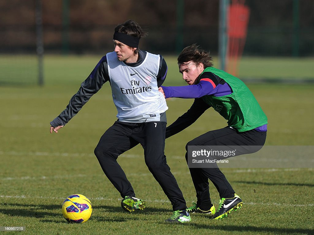 <a gi-track='captionPersonalityLinkClicked' href=/galleries/search?phrase=Tomas+Rosicky&family=editorial&specificpeople=213988 ng-click='$event.stopPropagation()'>Tomas Rosicky</a> and <a gi-track='captionPersonalityLinkClicked' href=/galleries/search?phrase=Ignasi+Miquel&family=editorial&specificpeople=7446487 ng-click='$event.stopPropagation()'>Ignasi Miquel</a> of Arsenal during a training session at London Colney on February 08, 2013 in St Albans, England.