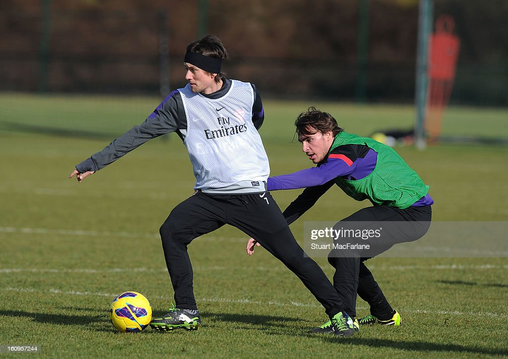 Tomas Rosicky and Ignasi Miquel of Arsenal during a training session at London Colney on February 08, 2013 in St Albans, England.