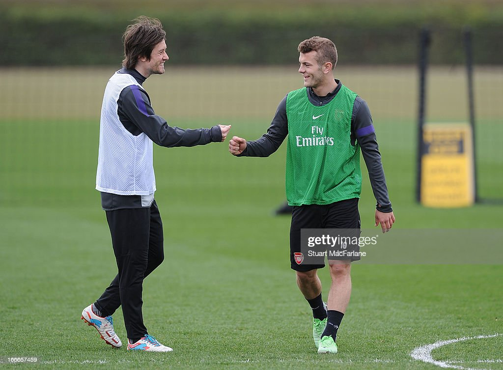 Tomas Rosicky and Jack Wilshere of Arsenal during a training session at London Colney on April 15, 2013 in St Albans, England.