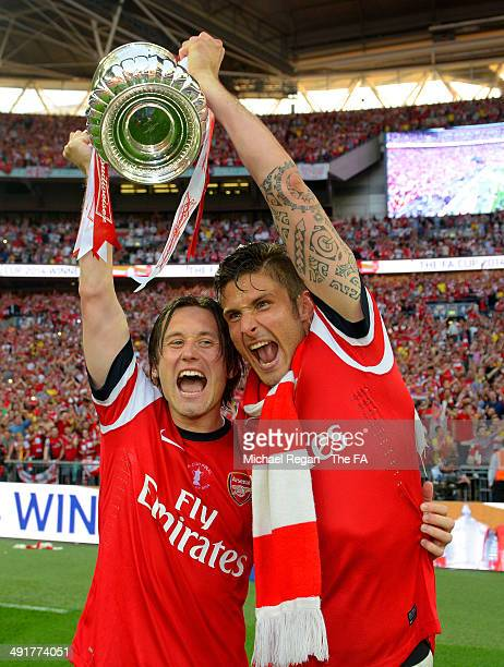 Tomas Rosicky and Olivier Giroud of Arsenal celebrate with the FA Cup after the FA Cup with Budweiser Final match between Arsenal and Hull City at...