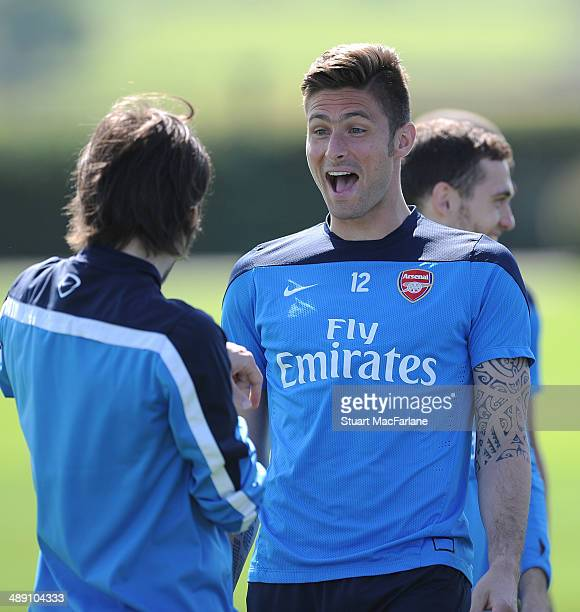 Tomas Rosicky and Olivier Giroud of Arsenal during a training session at London Colney on May 10 2014 in St Albans England
