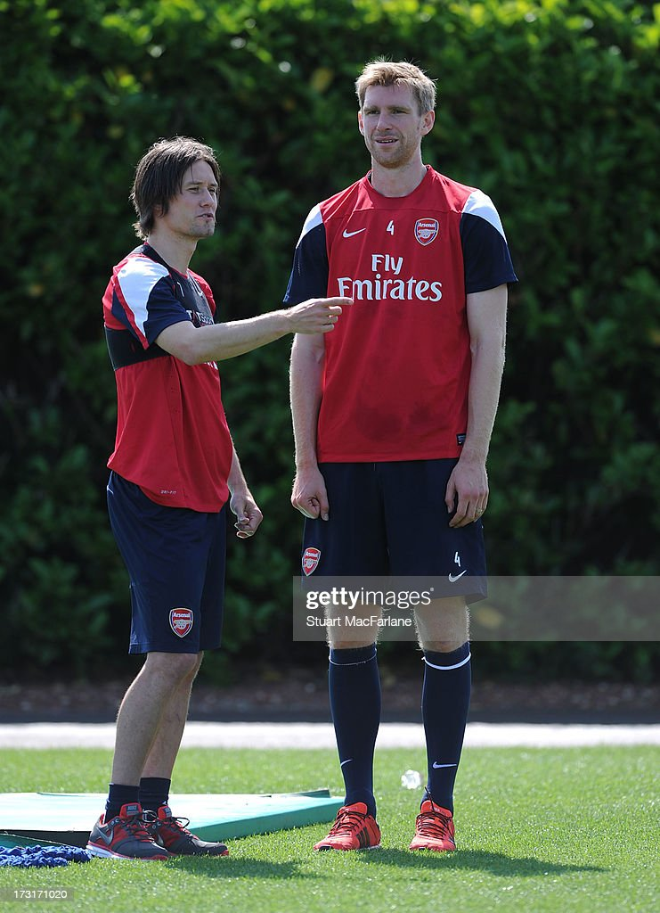 Tomas Rosicky and Per Mertesacker of Arsenal chat during a training session at London Colney on July 09, 2013 in St Albans, England.
