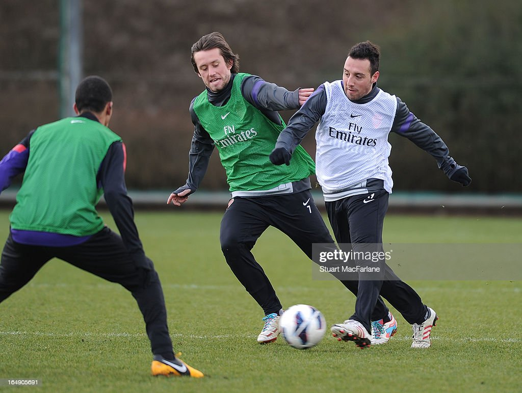 Tomas Rosicky and Santi Cazorla of Arsenal during a training session at London Colney on March 29, 2013 in St Albans, England.