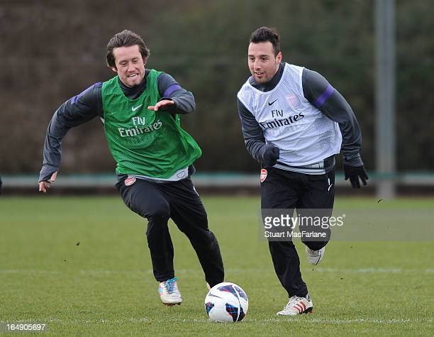 Tomas Rosicky and Santi Cazorla of Arsenal during a training session at London Colney on March 29 2013 in St Albans England