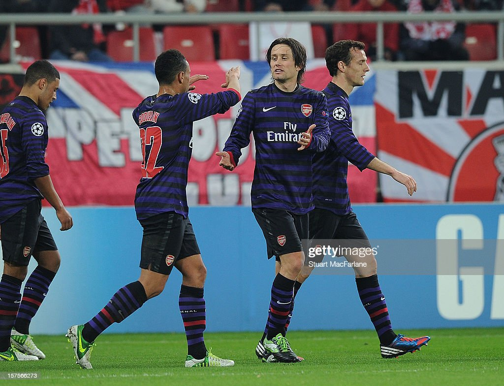 Tomas Rosicky (R) celebrates scoring the Arsenal goal with Francis Coquelin (L) during the UEFA Champions League Group B match between Olympiacos FC and Arsenal FC at Georgios Karaiskakis Stadium on December 04, 2012 in Athens, Greece.