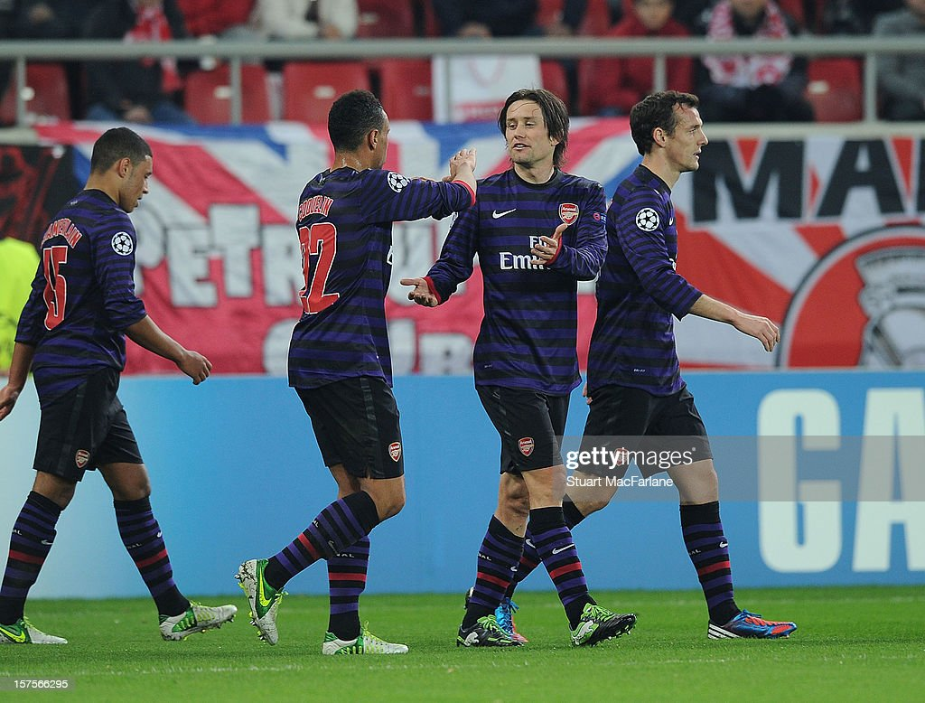 <a gi-track='captionPersonalityLinkClicked' href=/galleries/search?phrase=Tomas+Rosicky&family=editorial&specificpeople=213988 ng-click='$event.stopPropagation()'>Tomas Rosicky</a> (R) celebrates scoring the Arsenal goal with <a gi-track='captionPersonalityLinkClicked' href=/galleries/search?phrase=Francis+Coquelin&family=editorial&specificpeople=8957797 ng-click='$event.stopPropagation()'>Francis Coquelin</a> (L) during the UEFA Champions League Group B match between Olympiacos FC and Arsenal FC at Georgios Karaiskakis Stadium on December 04, 2012 in Athens, Greece.