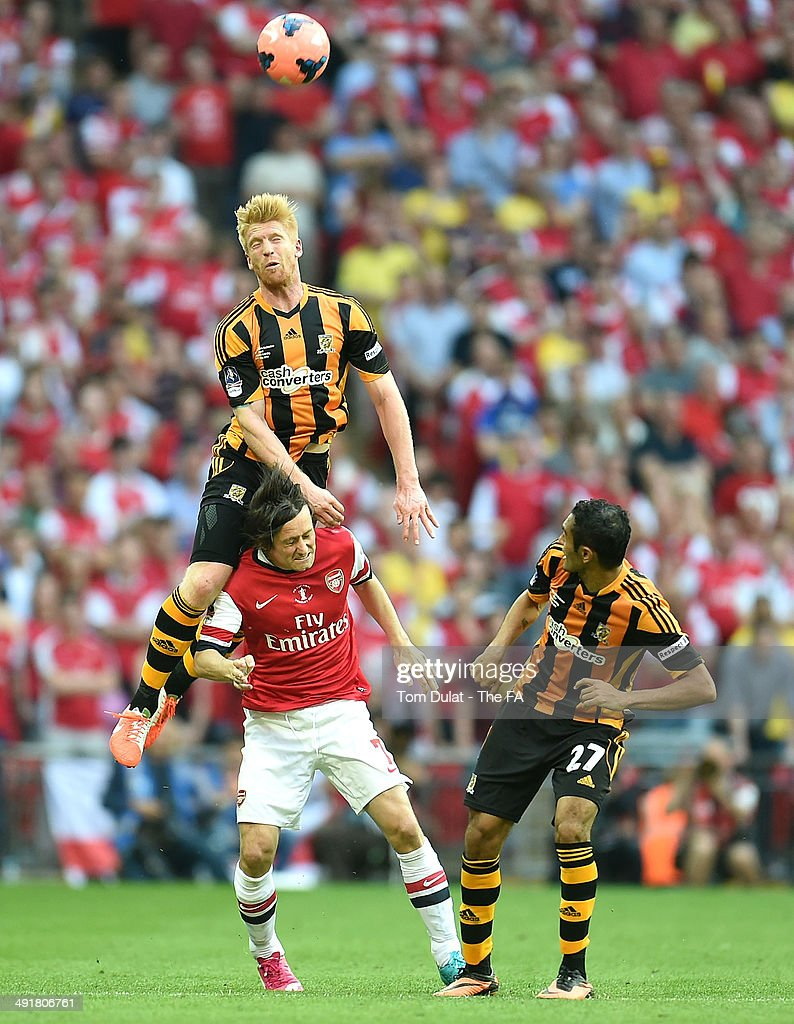 Tomas Rosicky of Arsenal and Paul McShane of Hull City battle for the ball during the FA Cup with Budweiser Final match between Arsenal and Hull City at Wembley Stadium on May 17, 2014 in London, England.