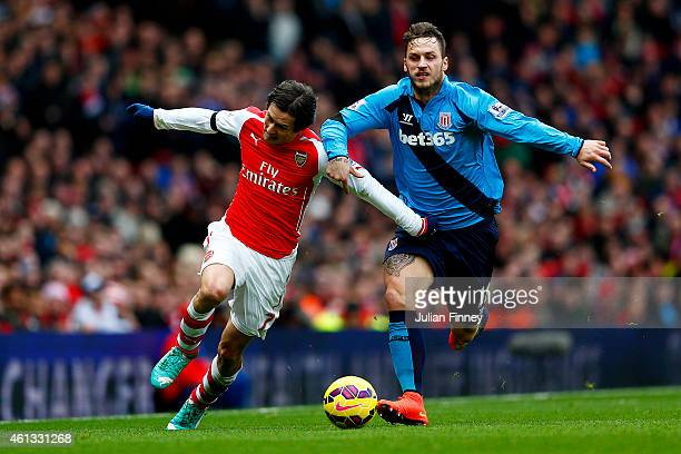 Tomas Rosicky of Arsenal battles for the ball with Marko Arnautovic of Stoke City during the Barclays Premier League match between Arsenal and Stoke...