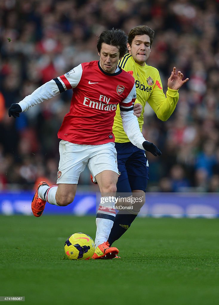 Tomas Rosicky of Arsenal battles with Marcos Alonso of Sunderland to score a goal during the Barclays Premier League match between Arsenal and Sunderland at Emirates Stadium on February 22, 2014 in London, England.