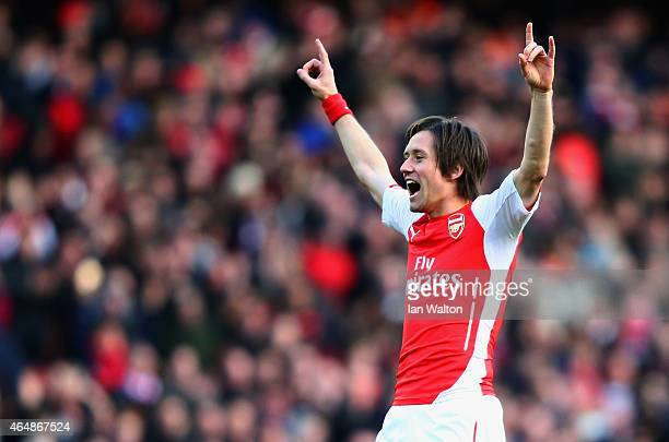 Tomas Rosicky of Arsenal celebrates as he scores their second goal during the Barclays Premier League match between Arsenal and Everton at Emirates...