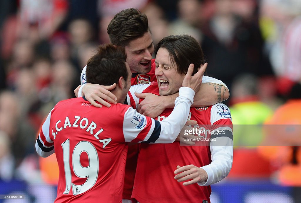 Tomas Rosicky of Arsenal celebrates his goal during the Barclays Premier League match between Arsenal and Sunderland at Emirates Stadium on February 22, 2014 in London, England.