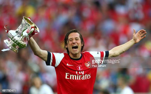 Tomas Rosicky of Arsenal celebrates victory with the trophy after the FA Cup with Budweiser Final match between Arsenal and Hull City at Wembley...