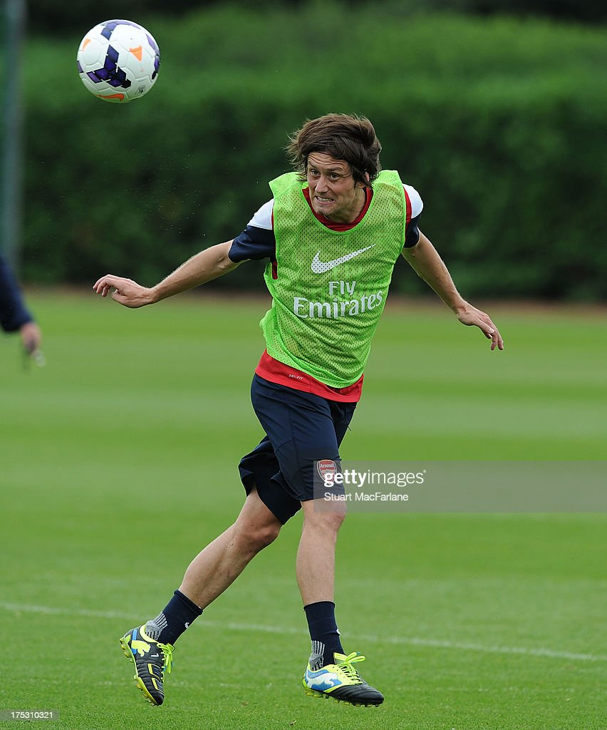 <a gi-track='captionPersonalityLinkClicked' href=/galleries/search?phrase=Tomas+Rosicky&family=editorial&specificpeople=213988 ng-click='$event.stopPropagation()'>Tomas Rosicky</a> of Arsenal in action during a training session at London Colney on August 02, 2013 in St Albans, England.