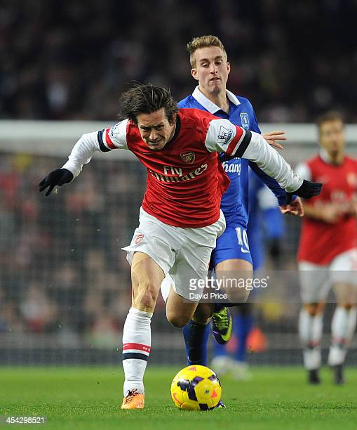 Tomas Rosicky of Arsenal is challenged by Gerard Delofeu of Everton during the Arsenal against Everton Premier League match at Emirates Stadium on...