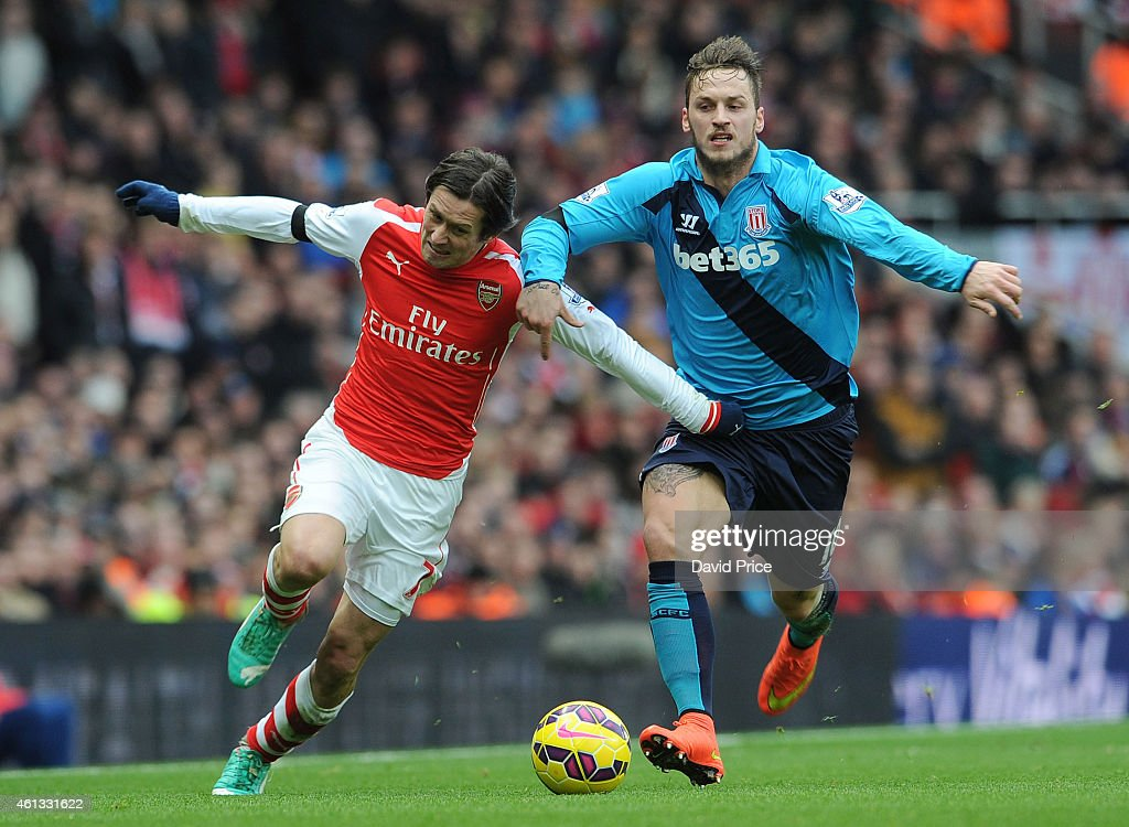 Tomas Rosicky of Arsenal is fouled by Marko Arnautovic of Stoke during the match between Arsenal and Stoke City in the Barclays Premier League at Emirates Stadium on January 11, 2015 in London, England.