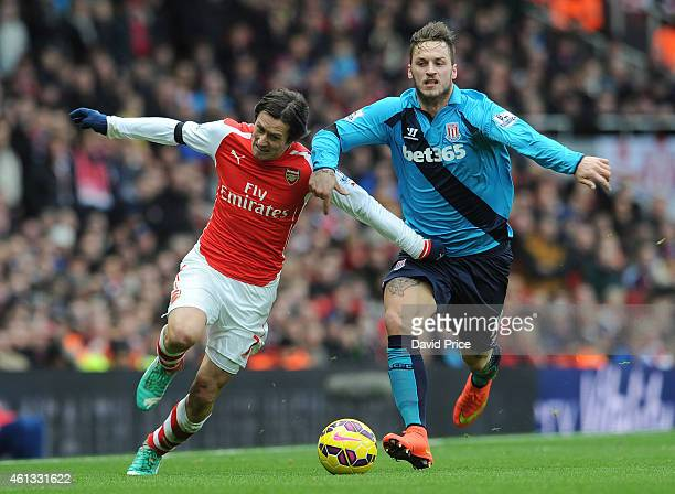 Tomas Rosicky of Arsenal is fouled by Marko Arnautovic of Stoke during the match between Arsenal and Stoke City in the Barclays Premier League at...