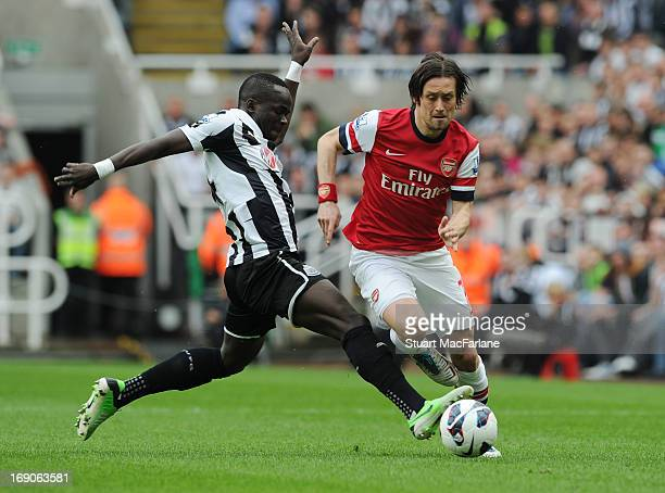 Tomas Rosicky of Arsenal is tripped by Cheick Tiote of Newcastle during the Barclays Premier League match between Newcastle United and Arsenal at St...