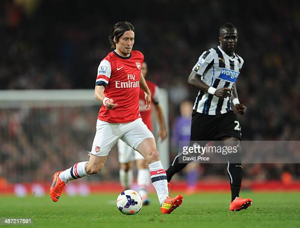 Tomas Rosicky of Arsenal races away from Cheick Tiote of Newcastle during the match between Arsenal and Newcastle United in the Barclays Premier...