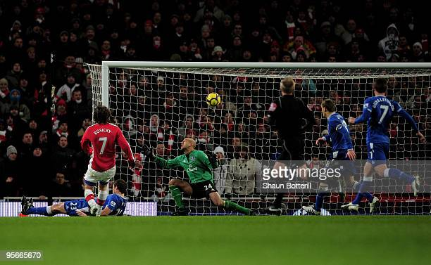 Tomas Rosicky of Arsenal scores a last minute equaliser during the Barclays Premier League match between Arsenal and Everton at Emirates Stadium on...