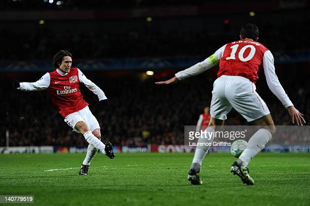Tomas Rosicky of Arsenal scores their second goal during the UEFA Champions League Round of 16 second leg match between Arsenal and AC Milan at...