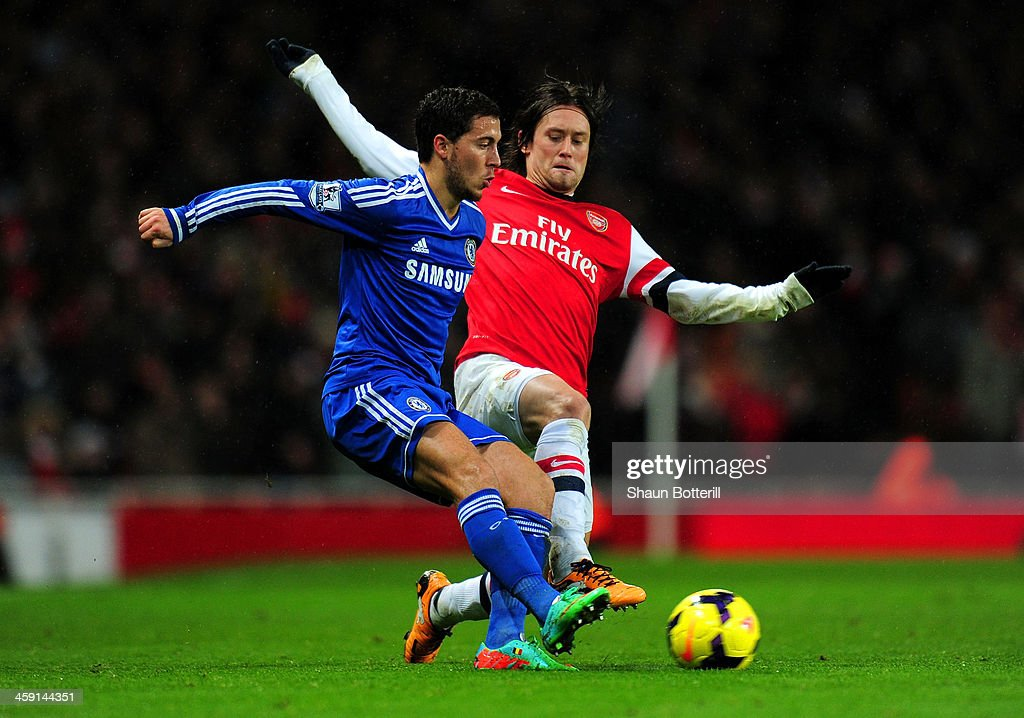 Tomas Rosicky of Arsenal tackles Eden Hazard of Chelsea during the Barclays Premier League match between Arsenal and Chelsea at Emirates Stadium on December 23, 2013 in London, England.