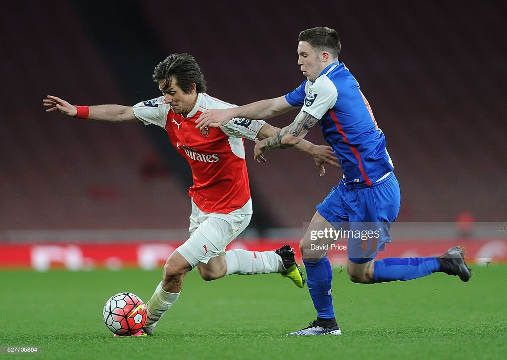 Tomas Rosicky of Arsenal takes on Connor Thomson of Blackburn during the match between Arsenal U21 and Blackburn Rovers U21 at Emirates Stadium on May 3, 2016 in London, England.