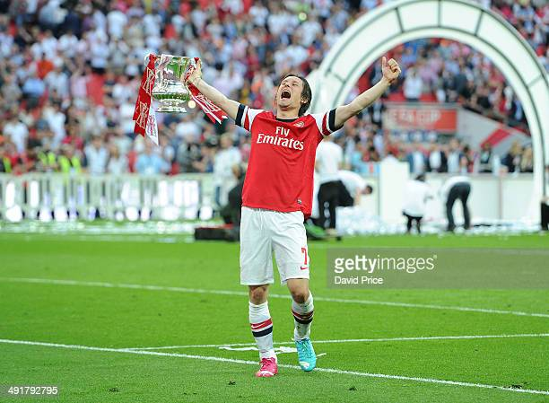 Tomas Rosicky of Arsenal with the FA Cup Trophy after the match between Arsenal and Hull City in the FA Cup Final at Wembley Stadium on May 17 2014...