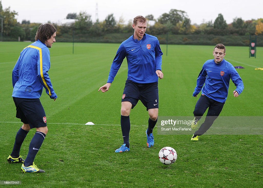 Tomas Rosicky, Per Mertesacker and Jack Wilshere of Arsenal during a training session at London Colney on October 21, 2013 in St Albans, England.