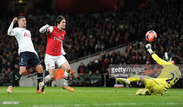 Tomas Rosicky scores Arsenal's 2nd goal past Hugo Lloris of Tottenham during the FA Cup 3rd Round match between Arsenal and Tottenham Hotspur at...