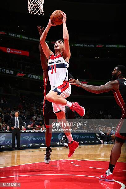 Tomas Satoransky of the Washington Wizards goes to the basket against the Miami Heat during a preseason game on October 4 2016 at Verizon Center in...
