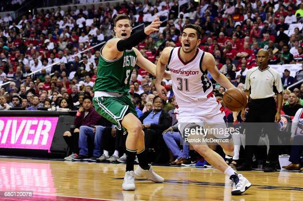 Tomas Satoransky of the Washington Wizards goes to the basket against Jonas Jerebko of the Boston Celtics in the second quarter in Game Four of the...