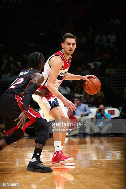 Tomas Satoransky of the Washington Wizards handles the ball against Briante Weber of the Miami Heat during a preseason game on October 4 2016 at...