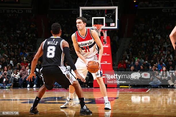 Tomas Satoransky of the Washington Wizards handles the ball against the San Antonio Spurs on November 26 2016 at Verizon Center in Washington DC NOTE...