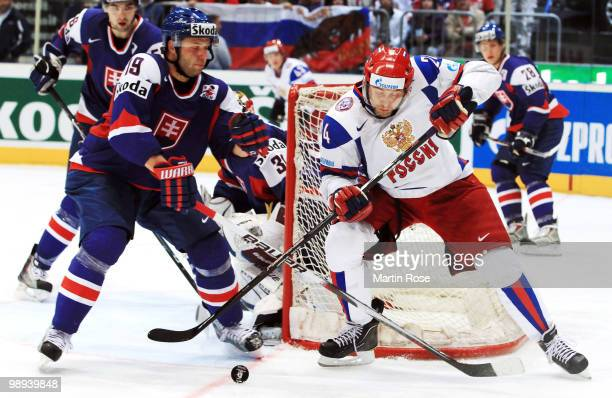 Tomas Stratos of Slovakia and Alexander Frolov of Russia battle for the puck during the IIHF World Championship group A match between Slovakia and...