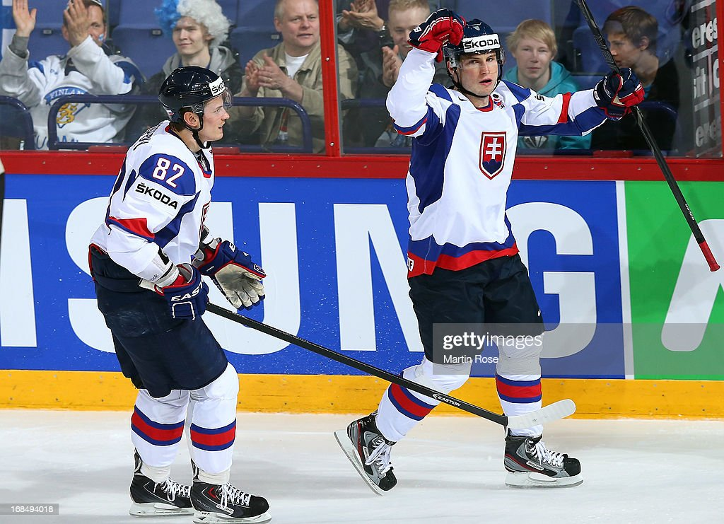 Tomas Surovy (R) of Slovakia celebrate with his team mate after he scores his team's first goal during the IIHF World Championship group H match between Slovakia and Austria at Hartwall Areena on May 10, 2013 in Helsinki, Finland.