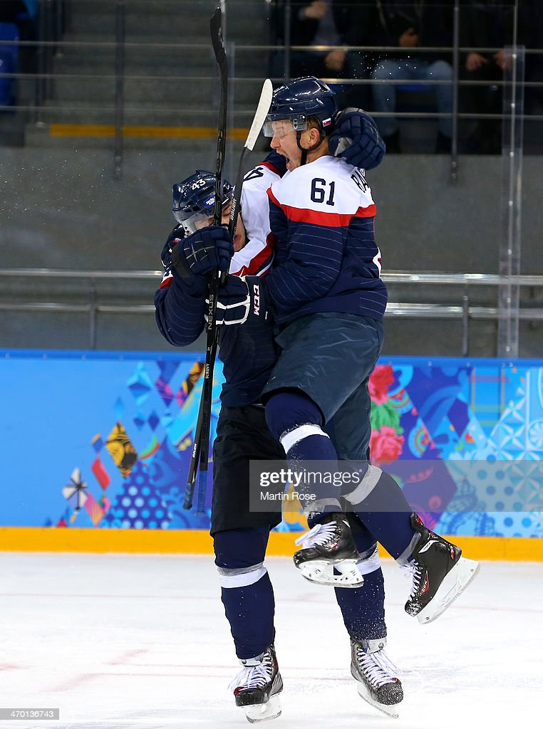 Tomas Surovy #43 of Slovakia celebrates his goal with Milan Bartovic #61 against Czech Republic in the third periodsvk43#3; Milan Bartovic during the Men's Qualification Playoff Game on day 11 of the Sochi 2014 Winter Olympics at Shayba Arena on February 18, 2014 in Sochi, Russia.