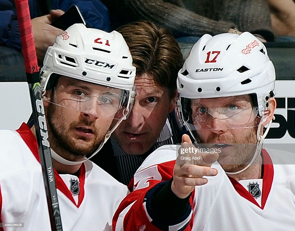 <a gi-track='captionPersonalityLinkClicked' href=/galleries/search?phrase=Tomas+Tatar&family=editorial&specificpeople=5652303 ng-click='$event.stopPropagation()'>Tomas Tatar</a> #21, <a gi-track='captionPersonalityLinkClicked' href=/galleries/search?phrase=Daniel+Cleary&family=editorial&specificpeople=220490 ng-click='$event.stopPropagation()'>Daniel Cleary</a> #17 and Coach <a gi-track='captionPersonalityLinkClicked' href=/galleries/search?phrase=Mike+Babcock&family=editorial&specificpeople=226668 ng-click='$event.stopPropagation()'>Mike Babcock</a> of the Detroit Red Wings talk during NHL game action against the Toronto Maple Leafs November 22, 2014 at the Air Canada Centre in Toronto, Ontario, Canada.