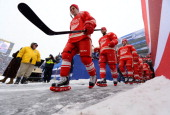 Tomas Tatar Jakub Kindl Darren Helm and their Detroit Red Wings teammates walk to the ice surface for warmup during the 2014 Bridgestone NHL Winter...