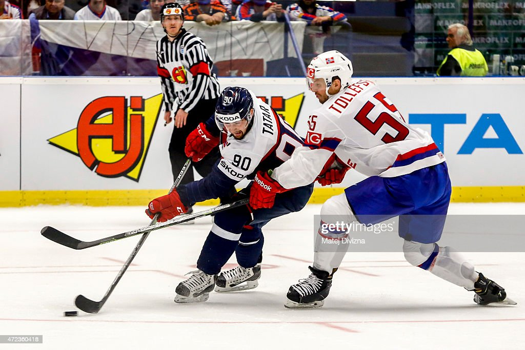 <a gi-track='captionPersonalityLinkClicked' href=/galleries/search?phrase=Tomas+Tatar&family=editorial&specificpeople=5652303 ng-click='$event.stopPropagation()'>Tomas Tatar</a> (L) of Slovakia and <a gi-track='captionPersonalityLinkClicked' href=/galleries/search?phrase=Ole-Kristian+Tollefsen&family=editorial&specificpeople=2129687 ng-click='$event.stopPropagation()'>Ole-Kristian Tollefsen</a> (R) of Norway battle for the puck during the IIHF World Championship group B match between Slovakia and Norway at CEZ Arena on May 6, 2015 in Ostrava, Czech Republic.