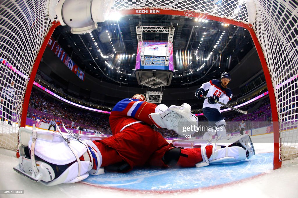 <a gi-track='captionPersonalityLinkClicked' href=/galleries/search?phrase=Tomas+Tatar&family=editorial&specificpeople=5652303 ng-click='$event.stopPropagation()'>Tomas Tatar</a> #90 of Slovakia misses a shot against <a gi-track='captionPersonalityLinkClicked' href=/galleries/search?phrase=Semyon+Varlamov&family=editorial&specificpeople=6264893 ng-click='$event.stopPropagation()'>Semyon Varlamov</a> #1 of Russia in a shoot out during the Men's Ice Hockey Preliminary Round Group A game on day nine of the Sochi 2014 Winter Olympics at Bolshoy Ice Dome on February 16, 2014 in Sochi, Russia.