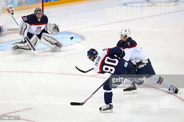 Tomas Tatar of Slovakia scores a goal against Jonathan Quick of United States in the second period during the Men's Ice Hockey Preliminary Round...