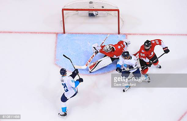 Tomas Tatar of Team Europe scores a goal on Carey Price of Team Canada as Marian Hossa of Team Europe battles with Brent Burns of Team Canada during...