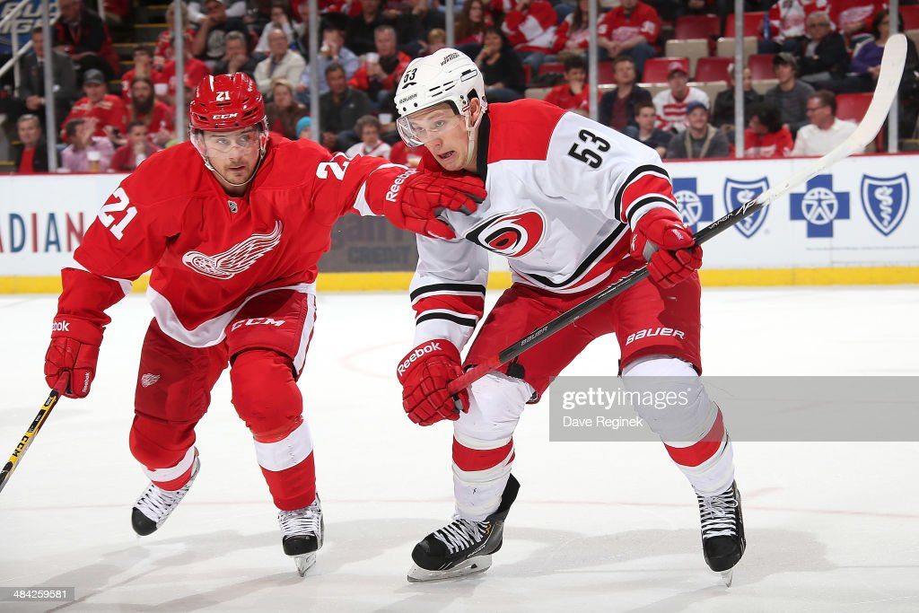 <a gi-track='captionPersonalityLinkClicked' href=/galleries/search?phrase=Tomas+Tatar&family=editorial&specificpeople=5652303 ng-click='$event.stopPropagation()'>Tomas Tatar</a> #21 of the Detroit Red Wings and <a gi-track='captionPersonalityLinkClicked' href=/galleries/search?phrase=Jeff+Skinner&family=editorial&specificpeople=3147596 ng-click='$event.stopPropagation()'>Jeff Skinner</a> #53 of the Carolina Hurricanes race for the puck during an NHL game on April 11, 2014 at Joe Louis Arena in Detroit, Michigan.