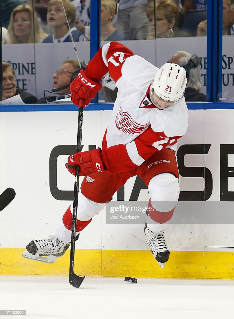 Tomas Tatar #21 of the Detroit Red Wings attempts to control the puck against the Tampa Bay Lightning during the second period in Game Five of the Eastern Conference Quarterfinals during the 2015 NHL Stanley Cup Playoffs at the Amalie Arena on April 25, 2015 in Tampa, Florida. The Red Wings defeated the Lightning 4-0.