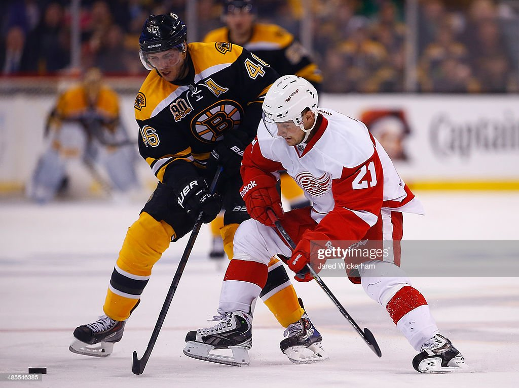Tomas Tatar #21 of the Detroit Red Wings battles for the puck against David Krejci #46 of the Boston Bruins in the third period in Game One of the First Round of the 2014 NHL Stanley Cup Playoffs at TD Garden on April 18, 2014 in Boston, Massachusetts.