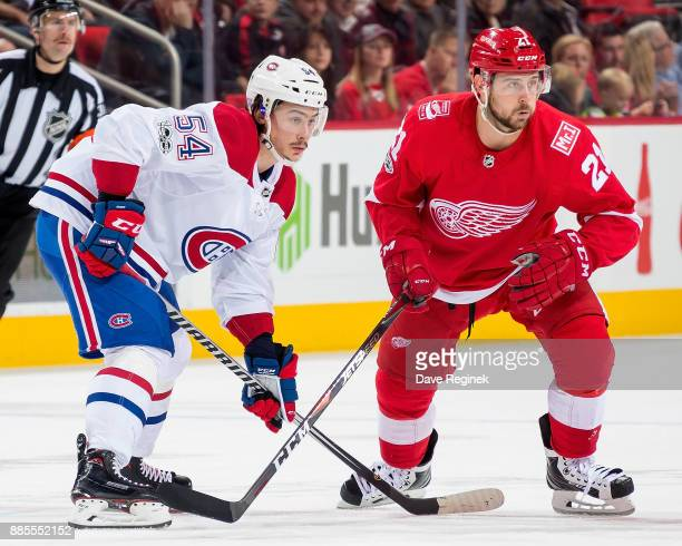 Tomas Tatar of the Detroit Red Wings battles for the puck with Charles Hudon of the Montreal Canadiens during an NHL game at Little Caesars Arena on...